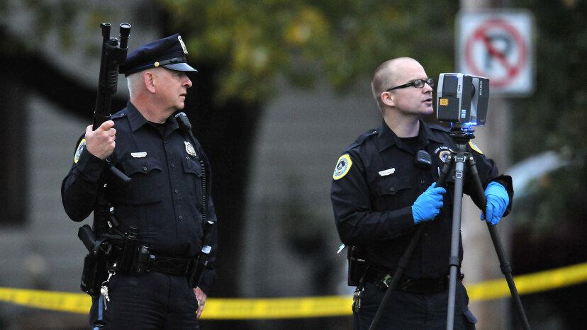 Des Moines police officers secure a crime scene