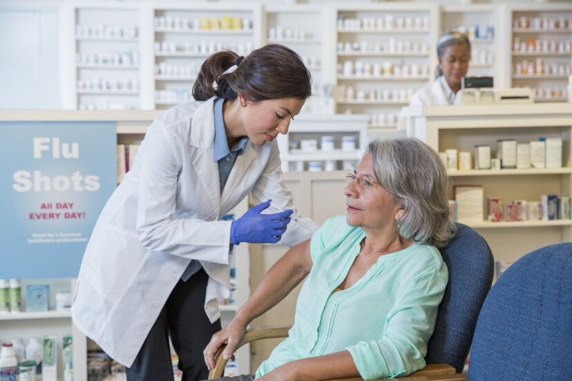 A woman gets a flu shot at a pharmacy. The website FluNearYou.org allows Americans to post flu symptoms and scientists use the info to track flu trends. Terry Vine/Getty Images