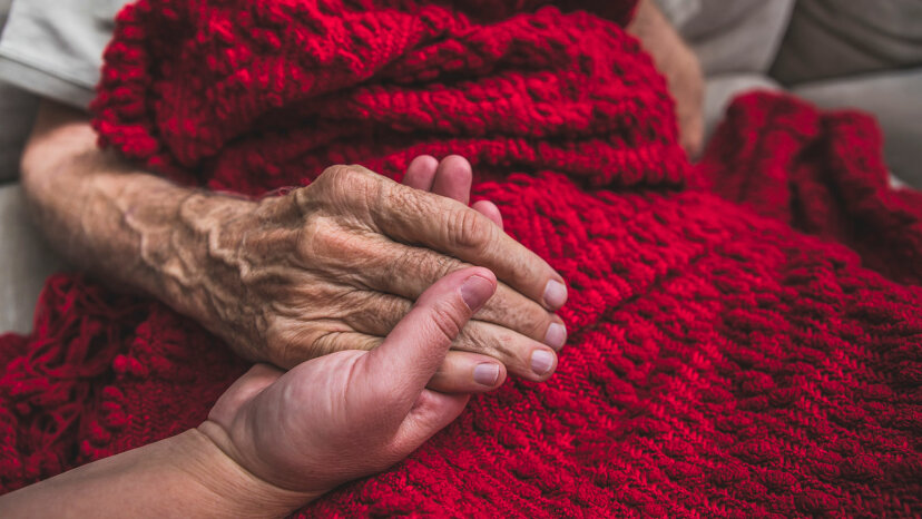 Hospice nurse visiting an elderly male patient