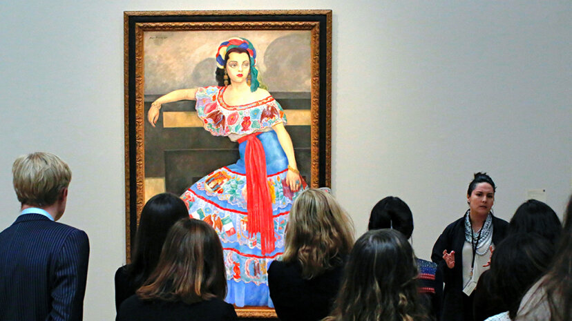 Viewers look at a Diego Rivera painting on display in New York in 2017. Rivera is one of many notable Mexican artists who've paid their tax obligations with artwork. Kena Betancur/AFP/Getty Images