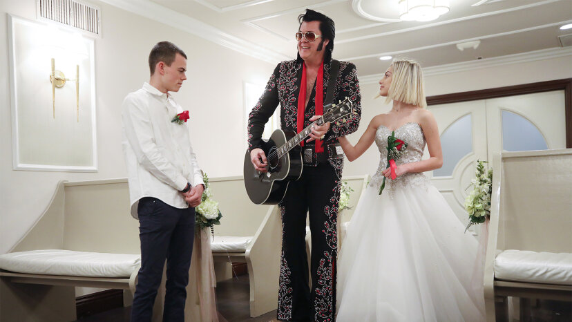 An Elvis impersonator sings for a couple at a wedding chapel in Las Vegas, Nevada.