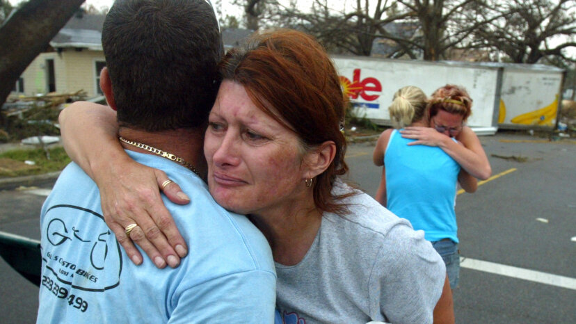 Petra Button (C) hugs her friend, Lewis Grant Martin, after seeing him for the first time since Hurricane Katrina, Sept. 1, 2005 in Gulfport, Mississippi.  Ross Taylor/Getty Images