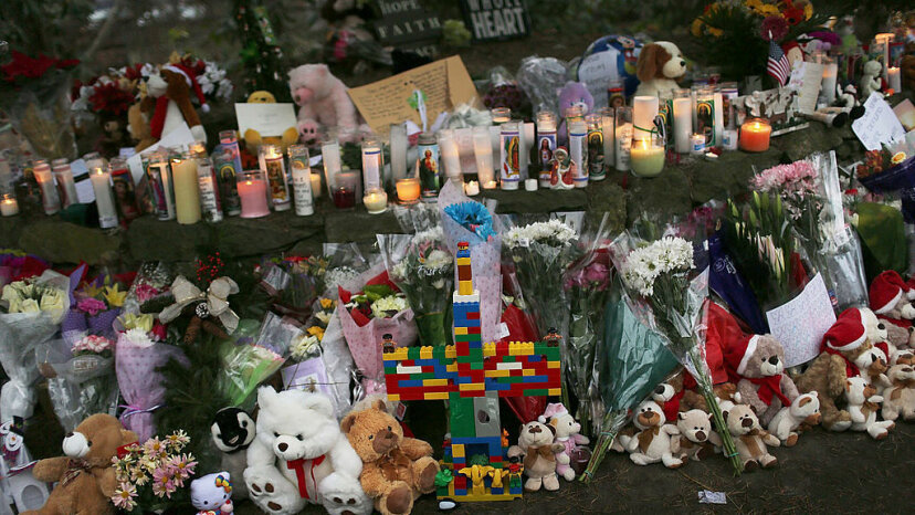 Teddy bears, flowers and candles are left at a memorial down the street from the Sandy Hook School in Newtown, Connecticut, Dec. 16, 2012. The town of 27,000 received 65,000 teddy bears after the school shooting that left 20 children dead.  Spencer Platt/Getty Images