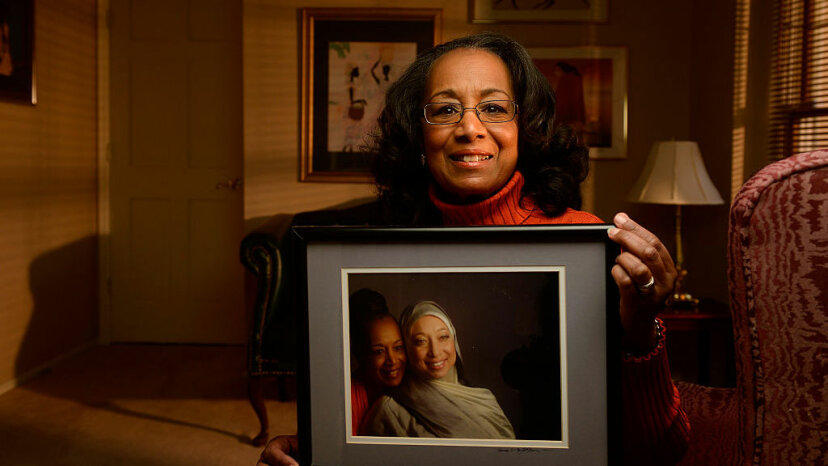 Colorado author Patricia Raybon shows photograph of her and her daughter Alana Raybon who lives in Nashville, Tennessee, in 2015. The two wrote a book, 'Undivided,' about how they healed their relationship after Alana converted to Islam from her Christian upbringing.  Cyrus McCrimmon/The Denver Post via Getty Images