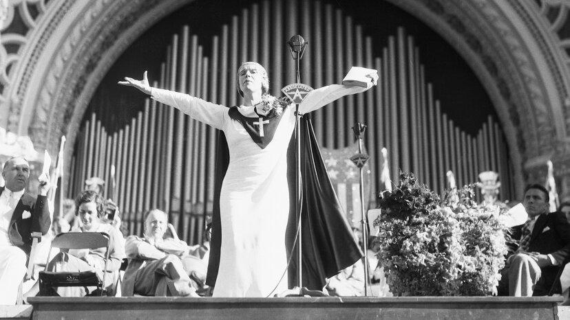 Twentieth-century evangelist Aimee Semple McPherson speaks in front of a crowd in 1935. Bettmann/Getty Images