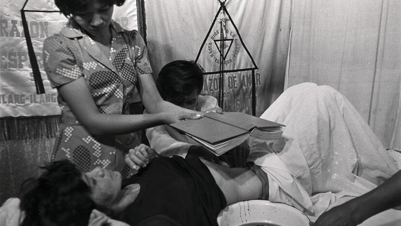 Filipino faith healer Alex Orbito treats a patient using psychic surgery, a pseudoscience that involves using nonhuman animal tissues to fake an operation. Bettmann/Getty Images