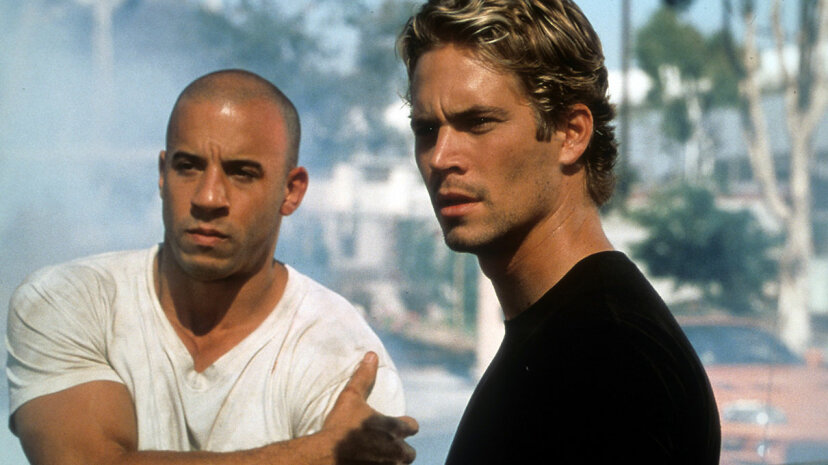 Vin Diesel (left) and the late Paul Walker in a scene from the 2001 film 'The Fast And The Furious.' This was one flick that critics didn't like but moviegoers did. It's now up to its seventh sequel. Universal/Getty Images