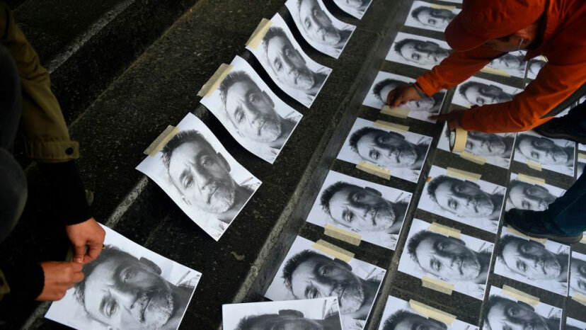 Journalists arrange pictures of Candido Rios during a demonstration demanding justice at the headquarters of the Ministry of the Interior in Mexico City on Aug. 24, 2017. At the time Rios was the 10th journalist murdered in Mexico for the year. PEDRO PARDO/AFP/Getty Images