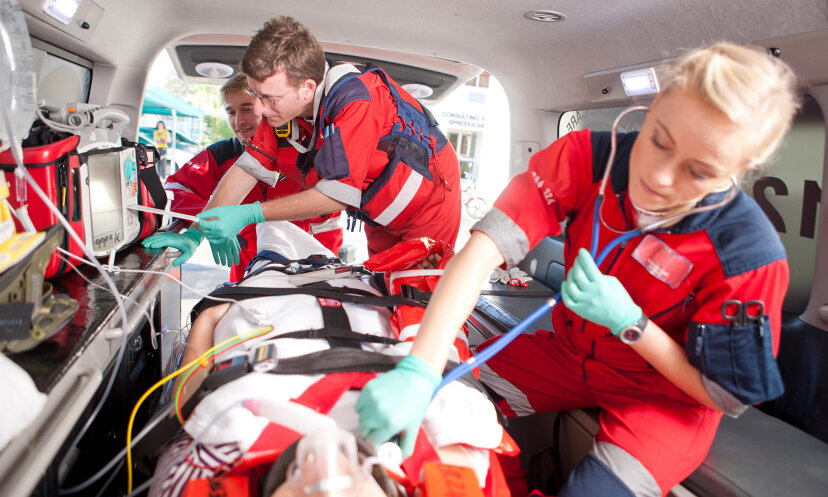 Paramedics using stethoscope on patient in ambulance Zero Creatives/Cultura/Getty Images