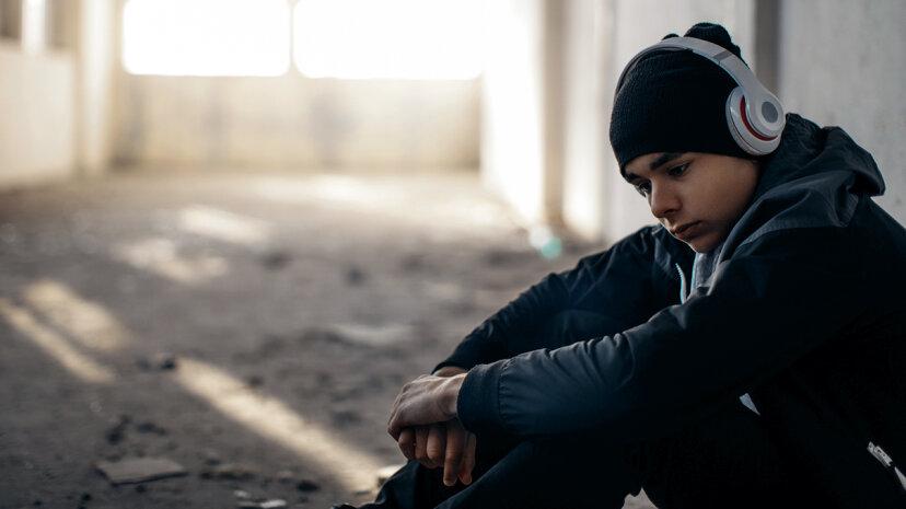 depressed teen listening to music