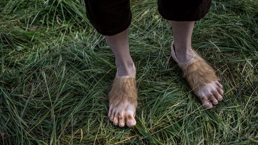 """A person dressed as Frodo from J.R.R. Tolkien's """"The Hobbit"""" displays his hobbit feet. Considering their dumpy stature, did hobbits really have the endurance to travel so many miles and battle so many creatures? Matej Divizna/Getty Images"""
