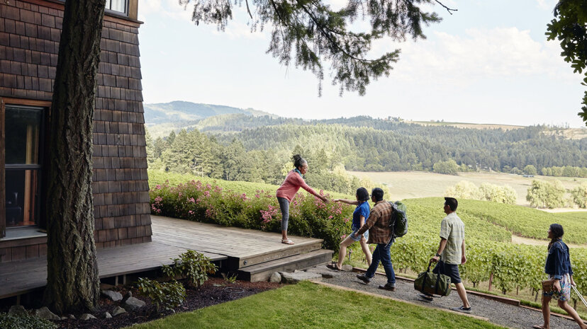 An Airbnb host greets guests at her home in Oregon. Airbnb