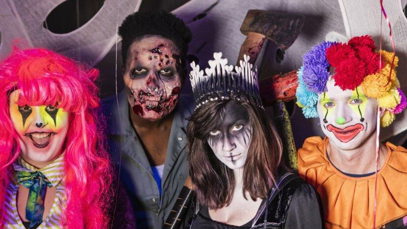 Teenagers wearing Halloween costumes