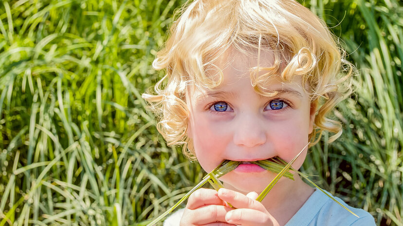girl eating grass