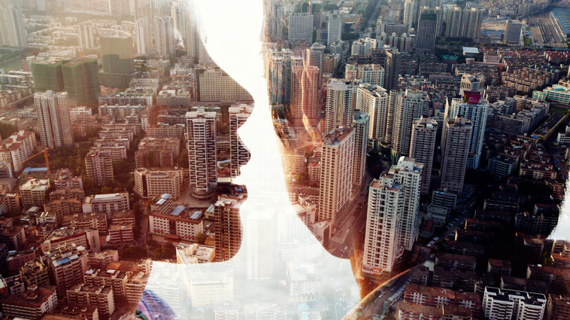 image of two people sharing secret over double exposure cityscape