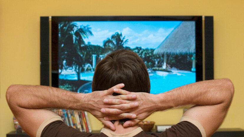 man watching LED TV