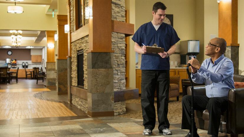 male nurse with elderly man