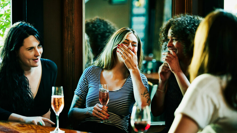 Group of women laughing in bar