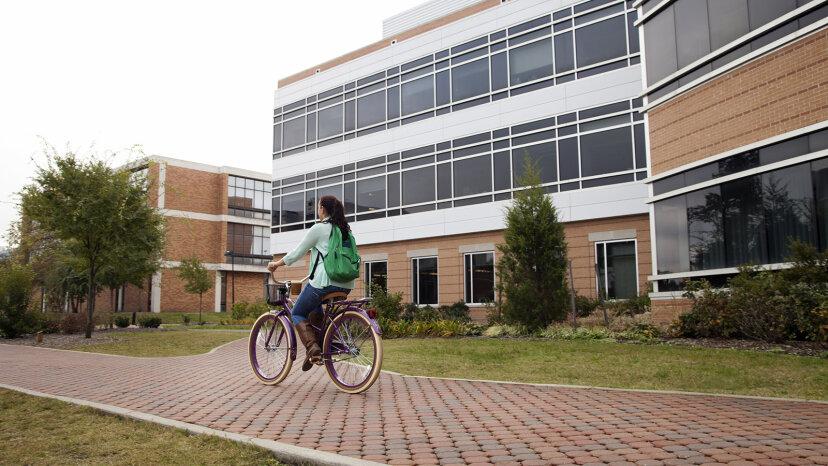 girl biking to class