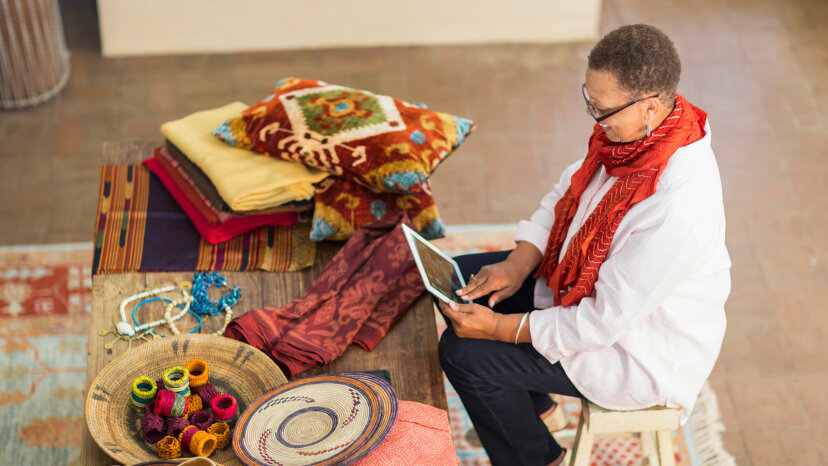 mature woman with crafts and digital tablet