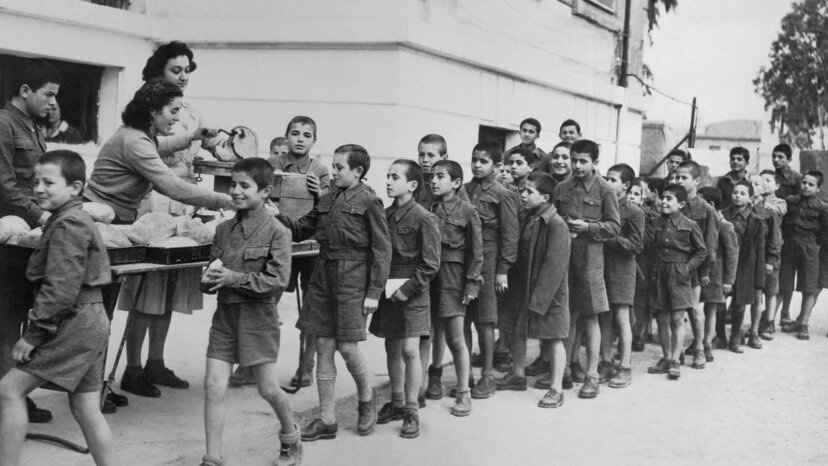 Children in Greece line up for bread