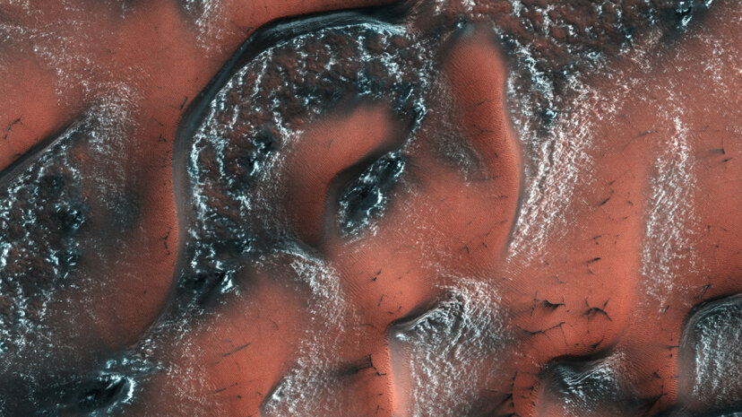 overhead shot of dunes on martian surface covered with snow