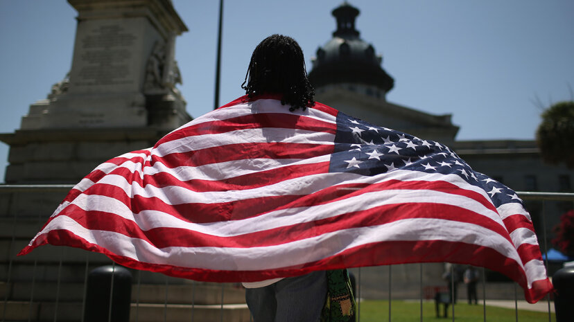 """Research has shown that white people are more closely associated with American identity than are minority groups, but a new study suggests gender moderates views of """"Americanness,"""" too. John Moore / Getty Images"""