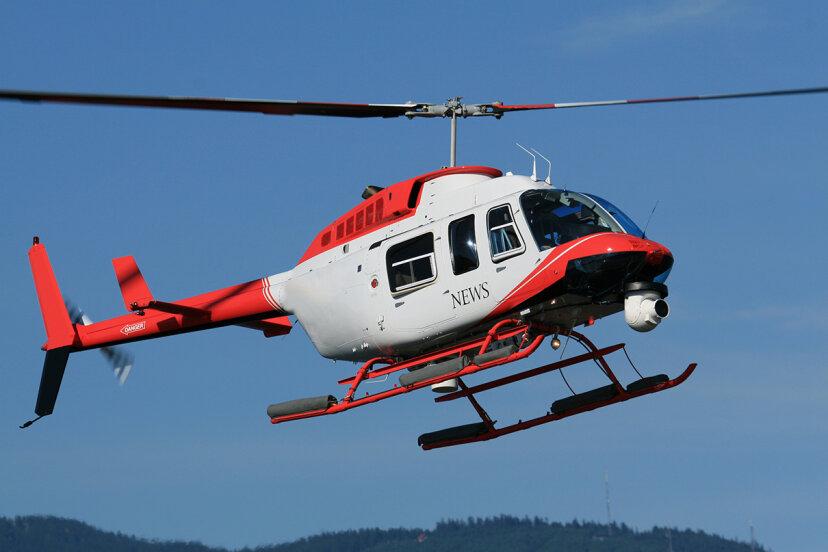 news helicopter above neighborhood