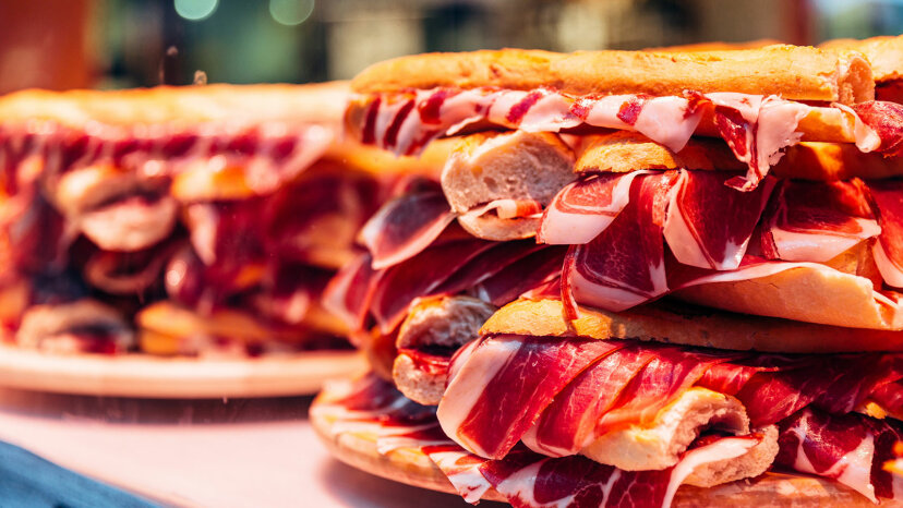Big jamon ham sandwich on a display in a cafe, Valencia, Spain