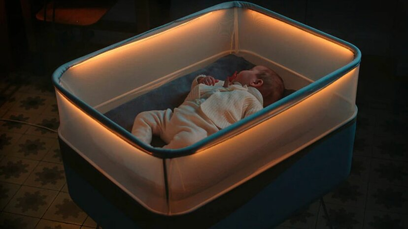 Ford's new concept crib is designed to mimic the sounds, lights and movements of a car ride, lulling newborns to sleep. Max Motor Dreams