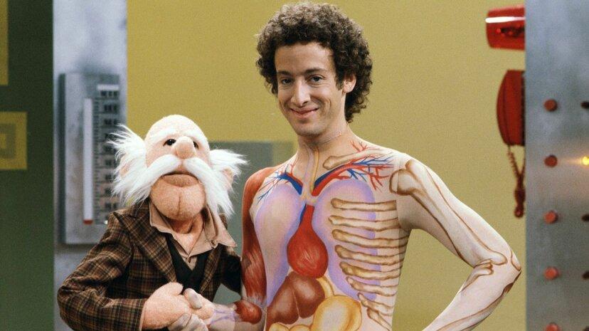 "Slim Goodbody (John Burstein) poses with the puppet Inspector Thiamin on ""Captain Kangaroo"" CBS via Getty Images"