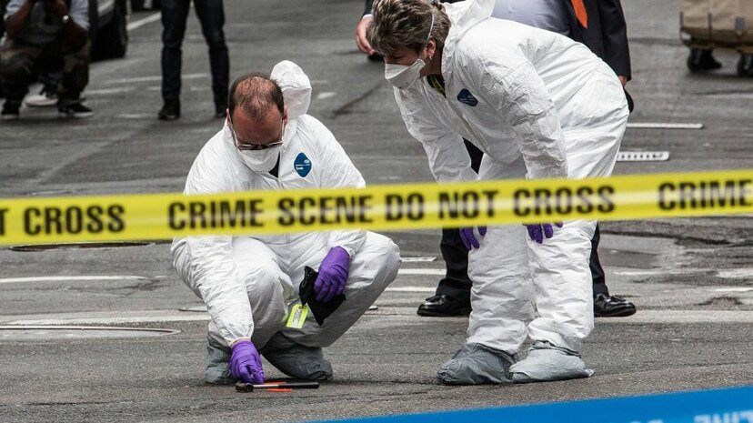 Crime scene investigators inspect a hammer used in an attack on a police officer on May 13, 2015 in New York City. Unlike what is portrayed on TV shows, DNA evidence is not always cut and dried. Andrew Burton/Getty Images