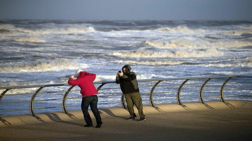 Anybody can be knocked over by wind, as long as it's blowing hard enough. OLI SCARFF/Stringer/Getty