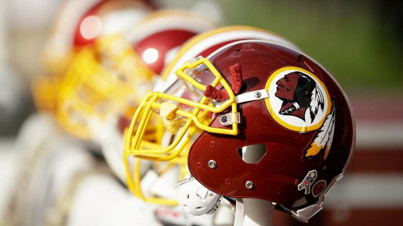 The Washington Redskins football team uses the profile of a Native American as a logo, offending many and courting controversy. Ezra Shaw/Getty Images