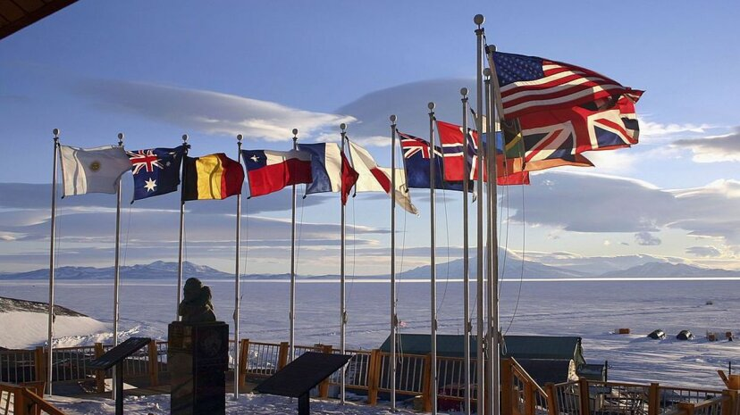 Flags of the original 12 signatory nations of the Antarctic Treaty fly next to a bust of Admiral Richard Byrd at McMurdo Station on October 21, 2005 in Antartica. Rob Jones/National Science Foundation via Getty images)