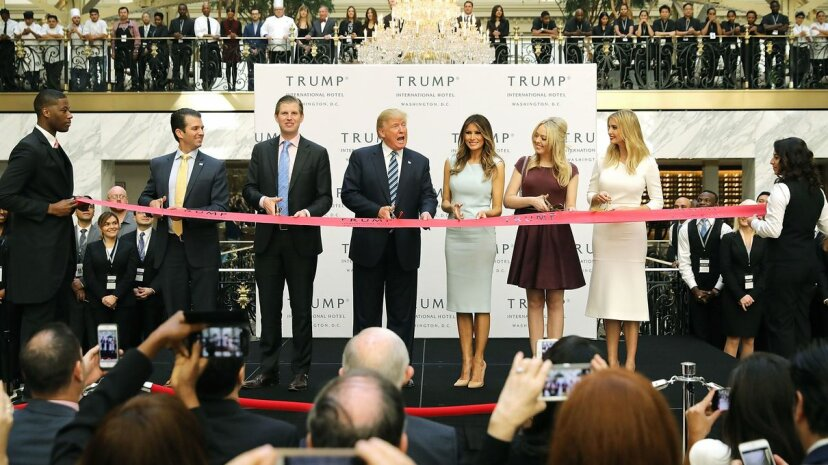 Donald Trump (C) and his family cut the ribbon at the new Trump International Hotel on Oct. 26, 2016, in Washington, D.C. The Trump Organization was granted a 60-year lease to the historic building by the federal government before the billionaire New York real estate mogul announced his intent to run for president.  Chip Somodevilla/Getty Images