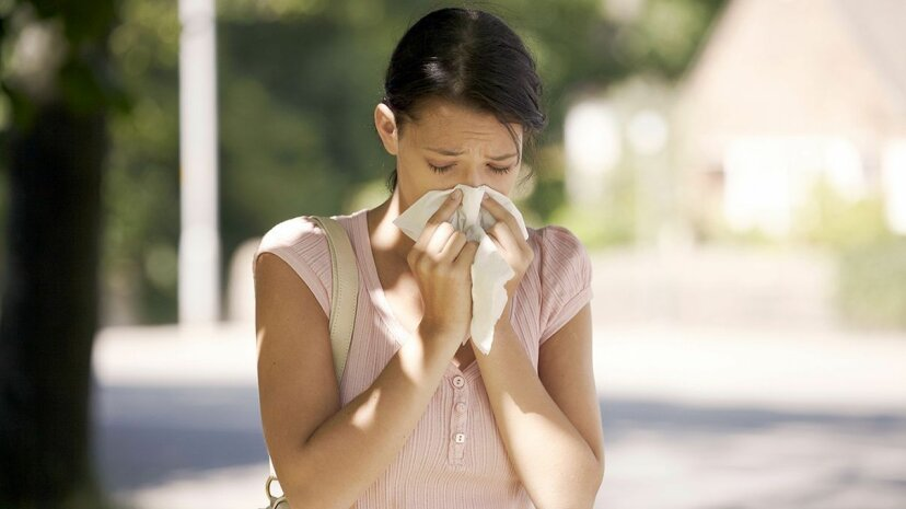 Seasonal allergies can flare up when you relocate and are exposed to new allergens. Martin Leigh/Getty