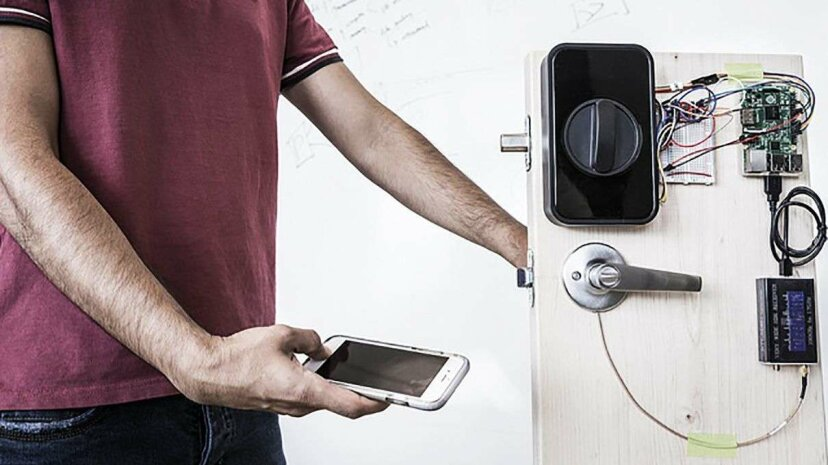 University of Washington engineers designed an electronic 'smart' lock mechanism that uses a smartphone to send a secure password through the human body and open a door. Mark Stone/University of Washington