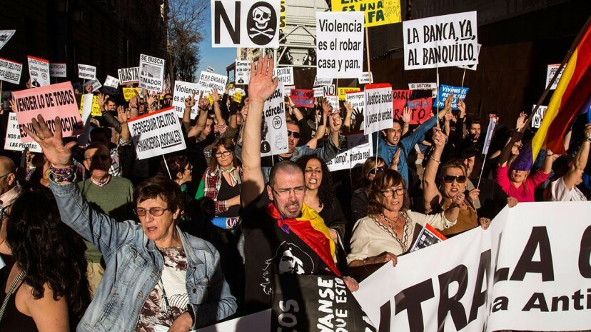 Protesters in Spain march in April 2017 against government corruption. Marcos del Mazo/LightRocket/Getty Images