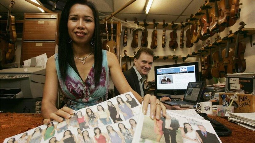 Lawrence Lynch poses with his Thai wife Thapenee, in Kidderminster, England, in 2006. The couple, who run a U.K. mail order bride agency from their music shop, have arranged hundreds of Thai women for clients and now use the Internet to introduce Weste... Christopher Furlong/Getty Images