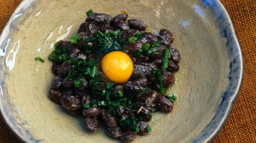 Kuro-mame natto, a Japanese dish of fermented soy beans garnished with a raw quail egg. Oliver Strewe/Getty Images