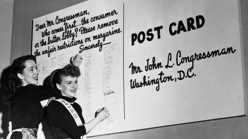 """Canadians weren't the only ones indignant about the tax on margarine. In this photo, Lisa Kirk (left), a Broadway star, and Millicent Coleman named """"Miss Margarine"""" add their names to a petition to Congress urging removal of restrictions on the sale of...  Bettmann/CORBIS"""