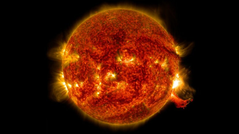 This NASA Solar Dynamics Observatory view of the sun highlights the magnetic solar corona and a powerful solar flare erupting on the limb. NASA/SDO