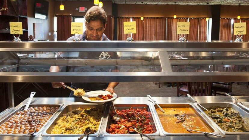 Some all-you-can-eat buffets have begun charging diners whose eyes are bigger than their stomachs. Katherine Frey/The Washington Post/Getty Images