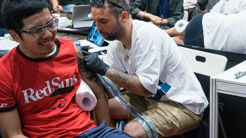 Getting and giving a tattoo both cause physical discomfort, as seen at the HK Tattoo Convention in Hong Kong. Yeung Kwan/Pacific Press/LightRocket via Getty Images