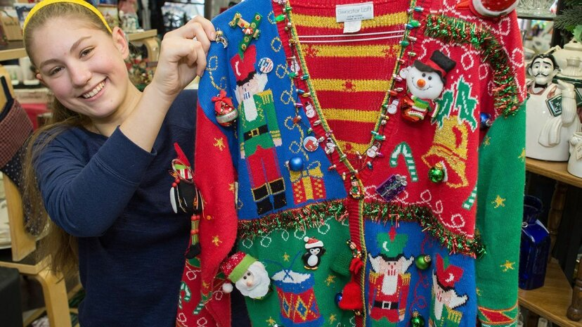 woman holding Christmas sweater