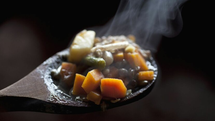 Which sounds more satisfying when you're hungry, warm stew or a plate of raw vegetables? Tobias Titz/Getty Images