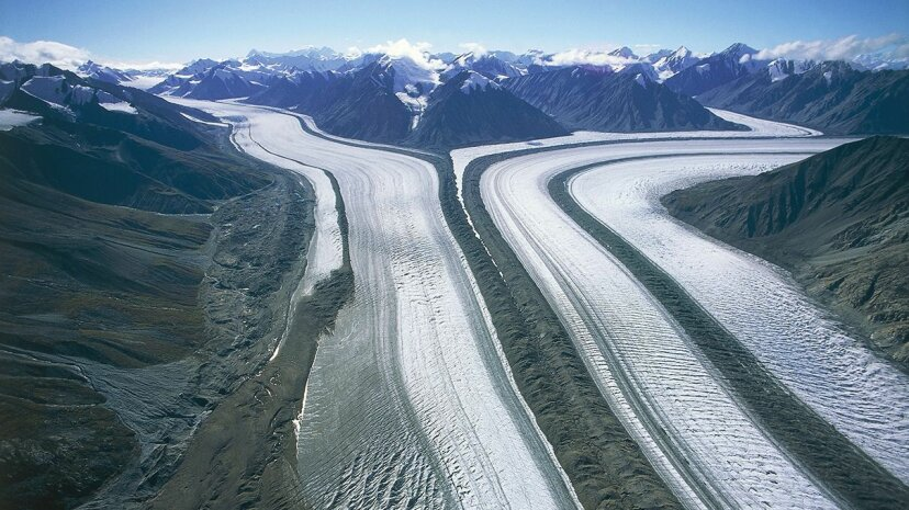 An aerial view of Kaskawulsh Glacier in Kluane National Park, Yukon, Canada. The UNESCO World Heritage site is undergoing rapid changes attributable to an altered climate. DEA/F. Barbagallo/De Agostini/Getty Images