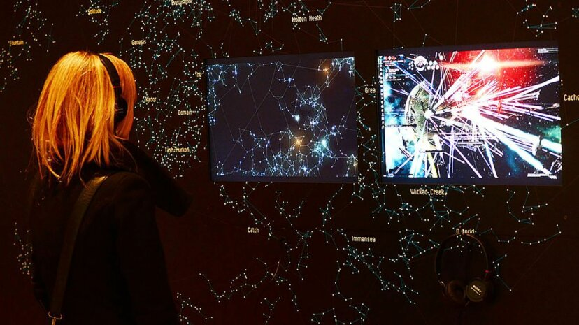 """A visitor looks at a display of the video game """"EVE Online"""" at the Museum of Modern Art in New York in 2013. Emmanuel Dunand/AFP/Getty Images"""