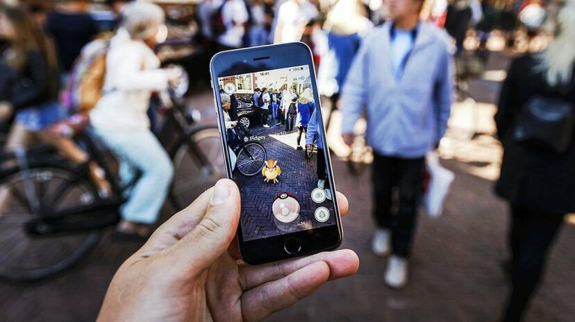"""""""Pokemon Go"""" lets players search the real world for virtual creatures to catch. REM KODEWAAL/AFP/Getty Images"""
